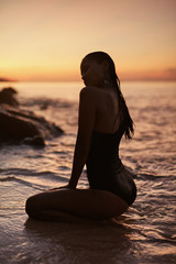 Summer. Woman With Sexy Body In Sea With Sunset On Background © puhhha