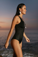 Woman Fashion. Stylish Girl In Swimsuit At Sea Coast At Sunset © puhhha