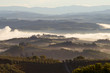 Previously foggy autumn morning in Tuscany. Surroundings of San Gimignano, Italy