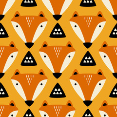 Muzzle of foxes, hand drawn backdrop. Colorful seamless pattern with muzzles of animals. Cute wallpaper, good for printing. Overlapping background vector. Design illustration © Talirina