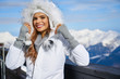 Leinwanddruck Bild - Portrait of a beautiful woman in the middle of the snowy mountains