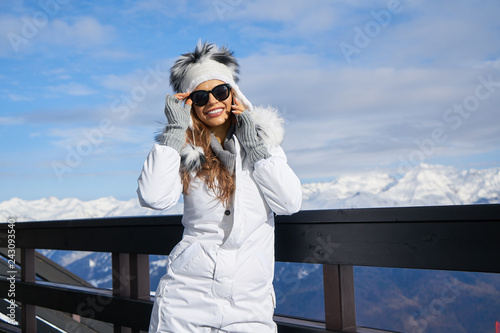 Leinwanddruck Bild Portrait of a beautiful woman in the middle of the snowy mountains