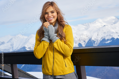 Portrait of a beautiful woman in the middle of the snowy mountains