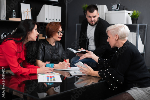 Poster Office workers discuss their project over Cup of tea