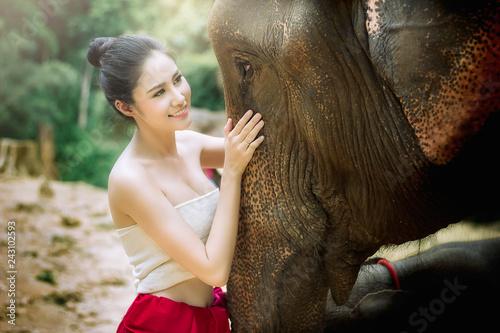 Portrait beautiful asian model with elephant