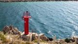 Red lighthouse near the port of Makarska, Croatia - 243106353