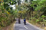 Motobikes driving on the road in Nusa Penida Island, Indonesia, Asia - 243107775