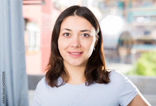 Leinwanddruck Bild Positive girl having good time standing in home interior