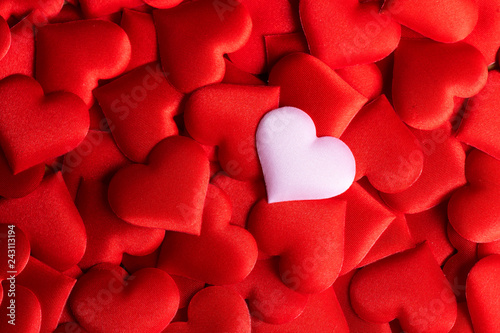 Valentine's Day. Holiday abstract red Valentine background with satin hearts. Love concept