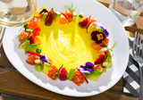 Raw salmon tartare with fruits, vegetables, flowers