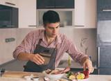 Man preparing food in kitchen - 243119303