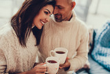Attractive woman sitting in cafe with her man - 243119304
