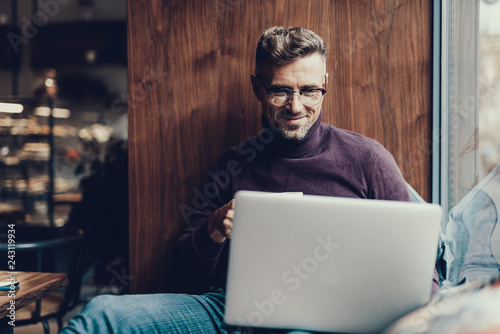 Man looking on netbook monitor and smiling © YakobchukOlena