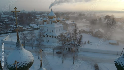 Aerial Camera dolly out between the domes of the church in winter