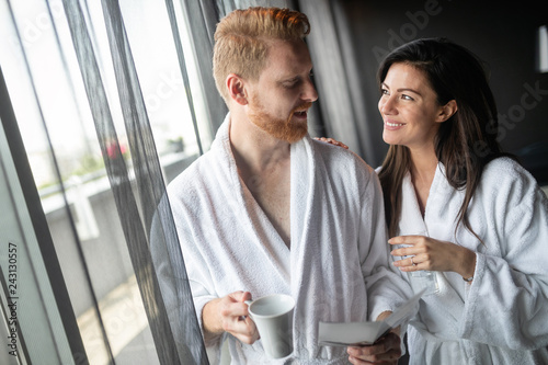 Happy married couple relaxing at wellness spa resort