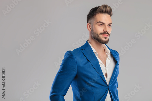 portrait of proud unshave businessman looking to side - 243131334