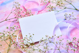 white card, background for greeting card women's day, Valentine's day. White flowers, yellow rose Petals, pink ribbons lie on a watercolor background in delicate pink, blue, yellow shades - 243133980