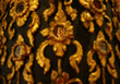 Closed Up the Face of Golden Buddha Image Reflecting on the Mirror of Teak Lacquered Pillar in Wat Phumin Temple, Nan Province, Thailand