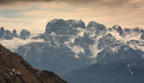 Snow-capped alps mountains in clouds - 243137738