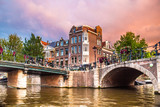 Amsterdam at sunset with canals and bridges