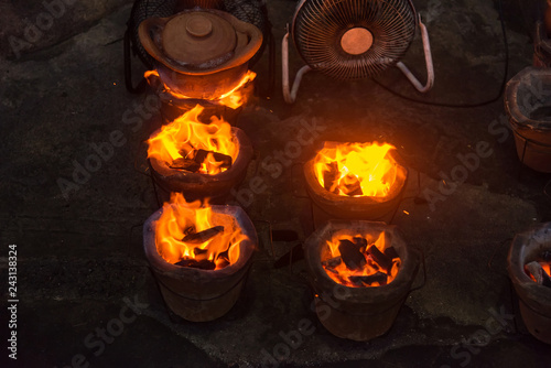 Foto Murales Fire will burning coal in stove.Thailand.