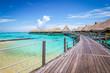Luxury travel vacation and honeymoon concept with overwater bungalow villas. Moorea, Tahiti, Bora Bora in French Polynesia.