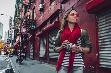 Attractive girl with a retro camera in Chinatown