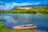 natural landscape with old wooden boat on the river shore - 243164944