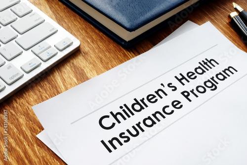 Foto Murales Childrens Health Insurance Program CHIP documents on a desk.