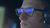 Close up of a computer game reflecting in gamer's glasses - 243169584