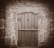 Old church door in brick wall. Bremen, Germany . Image in sepia color style