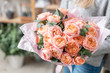 Leinwanddruck Bild - beautiful fresh cut bouquet of mixed flowers in woman hand. the work of the florist at a flower shop