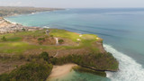 aerial view golf course on cape against ocean. golf course on tropical island on coastline.