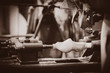 producing of a traditional dutch clog in a workshop. Holland, Netherlands . Image in sepia color style