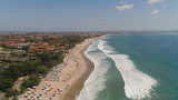 Aerial view sand beach with resting people, hotels and tourists, sun umbrellas, Bali, Kuta. surfers on water surface. Seascape, beach, ocean, sky sea Travel concept - 243177338