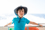Portrait of a boy on the deck of a pleasure ship. - 243185544