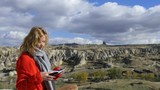 beautiful woman with map in valley Cappadocia - 243185960