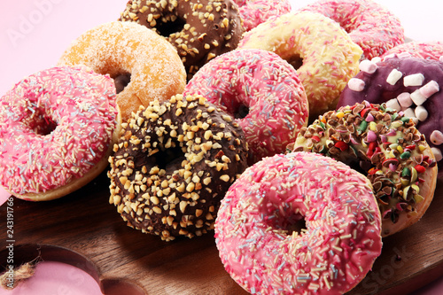 fototapeta na ścianę assorted donuts with chocolate frosted, pink glazed and sprinkles donuts