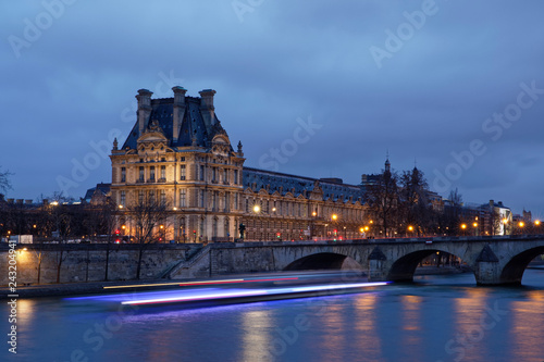 Wall mural Paris, France - January 12, 2018: Louvre museum viewed from Orsay quay