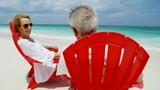 Mature Caucasian couple enjoying togetherness on beach Bahamas - 243212303