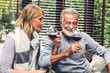 Senior couple relax talking and drinking wine glasses together on sofa in living room at home.Retirement couple concept - 243225921