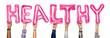 Leinwanddruck Bild - Hands showing healthy balloons word