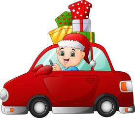 Cartoon boy driving a car carrying a presents © idesign2000