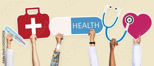 Leinwanddruck Bild Hands holding healthcare icons clipart