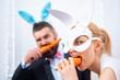 Easter egg couple. Smile easter. Cute bunny rabbit eating carrot. Easter bunny eat carrot.