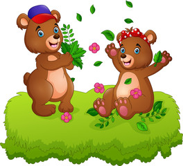 Cute couple of teddy bears playing with fallen leaves © idesign2000