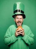 Happy St Patricks Day concept with pot of gold. Man on green background celebrate St Patricks Day. Patricks Day Pot of Gold and shamrocks. - 243231197
