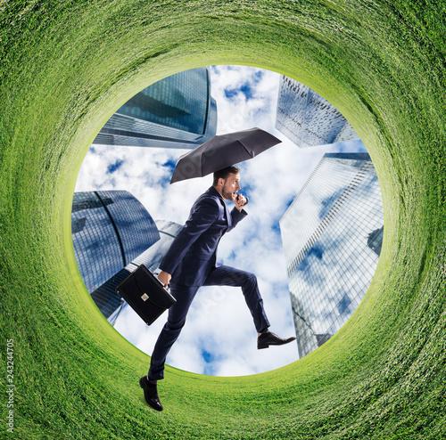Businessman running into green field circle. - 243244705