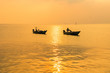 Beautiful sunrise on the beach and silhouette of fishing boat.Thailand.