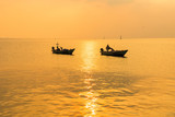 Beautiful sunrise on the beach and silhouette of fishing boat.Thailand. - 243250734